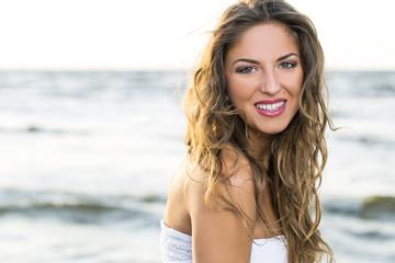 Pretty girl posing near the sea
