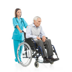 Nurse and patient. Confident young nurse walking with patient si