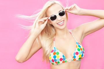 Beautiful young bikini girl wearing sunglasses