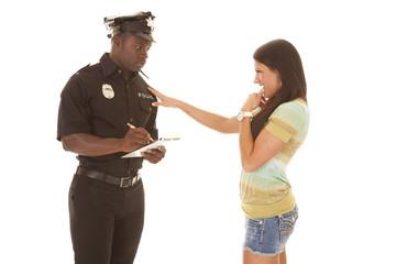 Policeman writing ticket woman flirting
