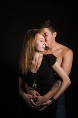 Beautiful young couple hugging and kissing