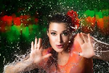 Beauty Brunette woman. Water Splash