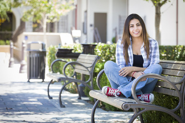 Mixed Race Female Student Portrait on School Campus Bench