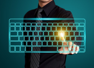 Wall Mural - Business man pressing virtual type of keyboard