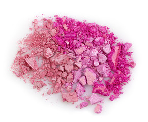 Pink crushed eye shadows on white background
