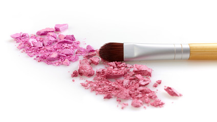 Pink shiny eye shadows and brush