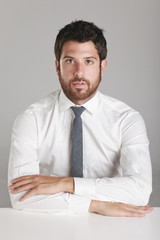 Portrait of a young businessman looking at camera.