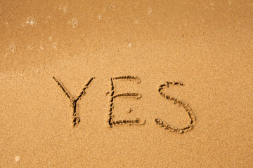 Yes - written in sand on beach texture (soft wave of the sea)