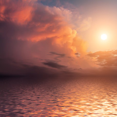 Dramatic sunset with clouds reflected in water.