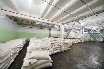 Sacks of corn grits for beer in factorн