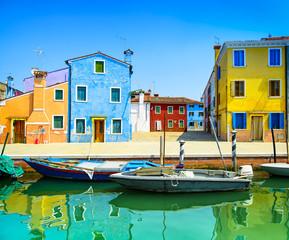 Venice landmark, Burano canal, houses and boats, Italy