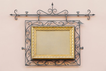 vintage frame decorated with wrought iron on the home wall of  h