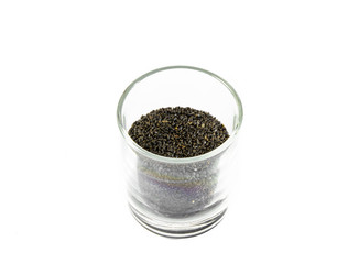 black sesame in small glass isolated