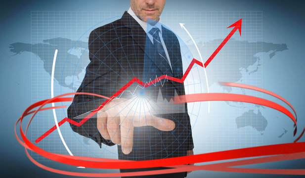 Businessman touching graph on futuristic interface with red arro