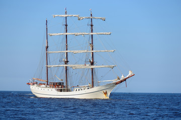 Canvas Prints Ship old historical tall ship with white sails in blue sea