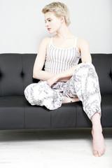 Woman sat on sofa