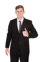 Businessman showing thumb up sign