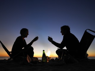 couple on the beach by night