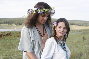 nice hippie couple embrace
