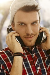 Closeup portrait of young man with headphones