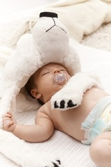 Sleeping infant with dummy and bear