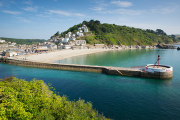 Fototapete - Looe harbour Cornwall England with blue sea and sky