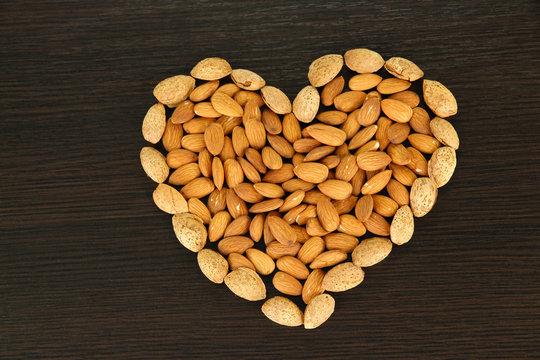 Almond on dark wooden background