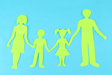 Family from paper on bright background