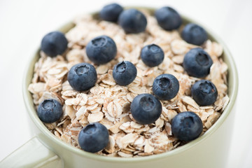 Cereals with ripe blueberries, horizontal shot, close-up