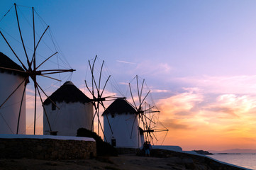 Sunset with famous windmills on Mykonos island, Greece