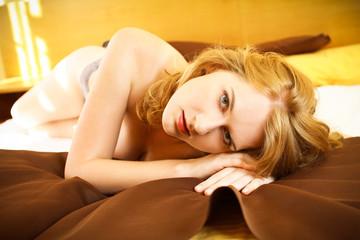 beautiful redhead in bed