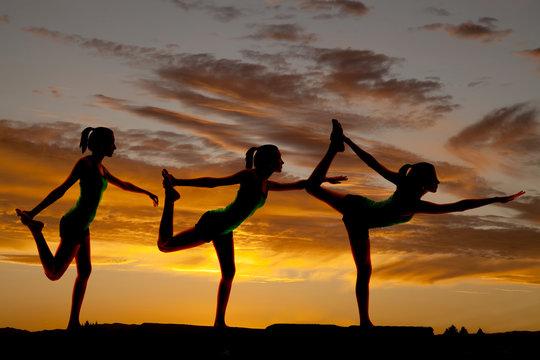 women silhouette scorpion pose