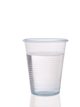 Plastic cup of water with reflection