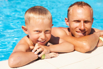 Father and son spent time in pool