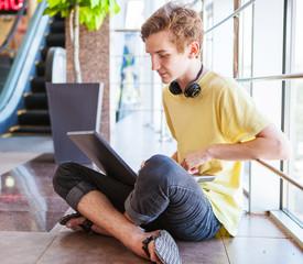 Handsome teenage boy using wifi internet connect