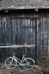 old broken bicycle at an village barn