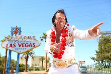 Foto op Canvas Las Vegas Elvis look-alike impersonator and Las Vegas sign