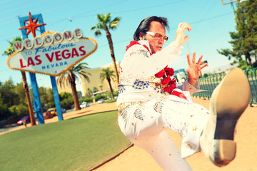 Elvis look-alike impersonator and Las Vegas sign