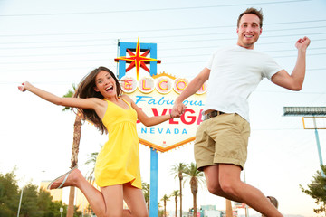 Wall Mural - Las Vegas Sign - Happy couple jumping
