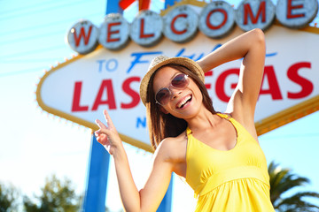 Wall Mural - Tourist woman in Las Vegas sign posing happy