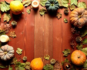 Pumpkins,candles and fall leaves.frame