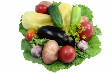 A variety of vegetables and salad. Presented on a white backgrou