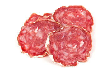 pile of salchichon, red spanish salami, on a white