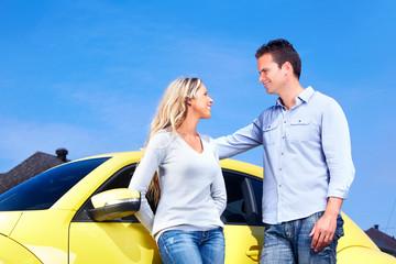 Couple near new car.