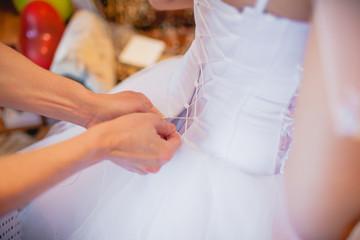 back of bride in wedding dress