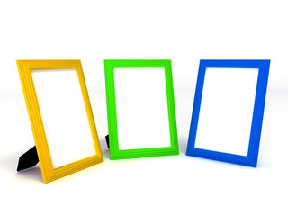 empty colorful frameworks for photos on white