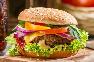 Closeup of homemade hamburger with fresh vegetables - fototapety na wymiar