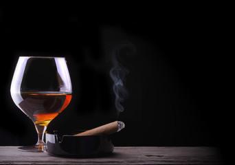 Cognac glass shrouded in a smoke