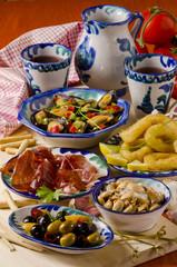 Spanish Cuisine. Assorted tapas on ceramic plates.