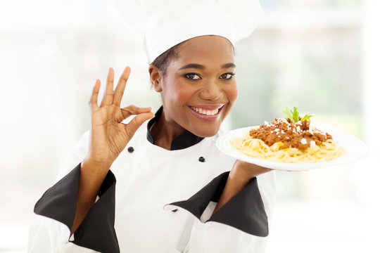 young african chef with delicious pasta